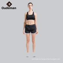 Suministro de poliéster / spandex conjunto completo de sujetador de yoga y corto en stock