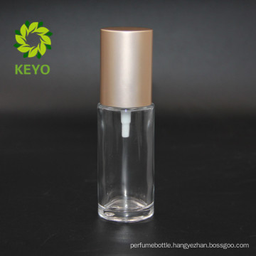 best selling 30ml empty clear cosmetic lotion glass bottle with gold pump cap