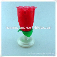 Flor rosa vela de cumpleaños musical con rotación