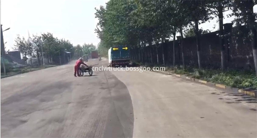 road sweep truck works on road