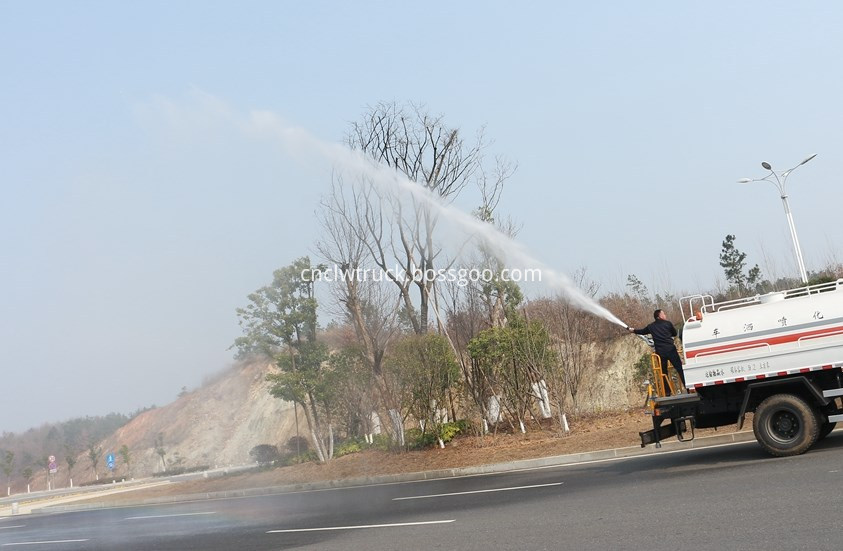 water spray truck in action 4