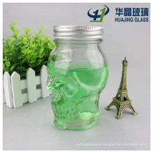 Transparent Embossed 450ml Skull Shape Glass Bottle with Metal Lids