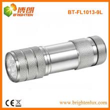 Fábrica por encargo de aluminio AAA seco alimentado por batería 9 llevado linternas baratos linternas