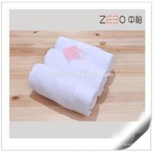 Toalla de algodón pura de venta caliente Toalla de mano blanca al por mayor baratos