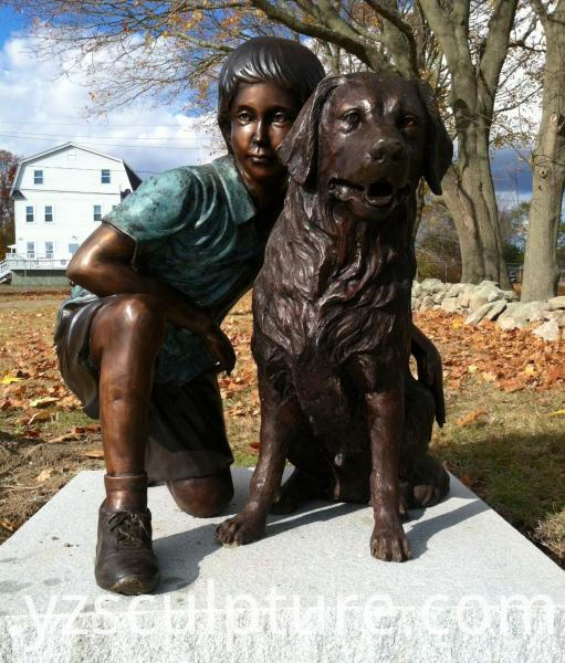 bronze boy and dog statue