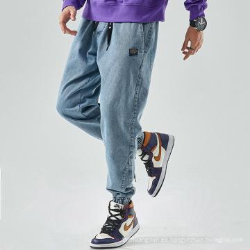 Versión suelta de jeans de moda de pie de paquete de ocio