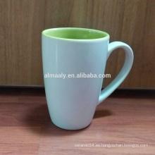 Taza coloreada coloreada al por mayor de la porcelana de la porcelana