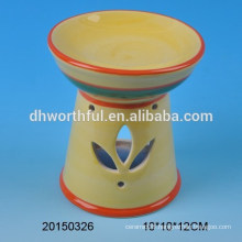Decorative ceramic fragrance oil burner with hollow out design