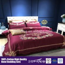 La couverture de couette de coton d'hôtel de luxe, couvertures de literie ont placé la taille de reine