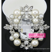 large pearl extra large stone brooch