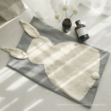 Los nuevos niños del estilo del NIÑO que duermen los niños de la manta sostienen la manta hecha punto de la manta
