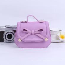 último diseño de los bebés del bowknot del bolso del bolso de escuela de moda casual para los niños precio al por mayor caramelo de color princesa monedero