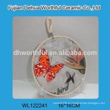 Porta-vasos de cerámica con diseño de mariposa