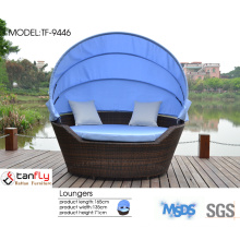 Outdoor garden furniture round rattan lounge chairs.