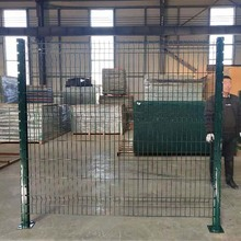 Green coated wire mesh residential security fence