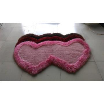Der Spezialformteppich mit einem oder zwei Herz