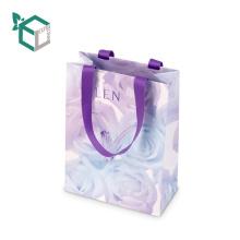 Las bolsas decorativas de lujo del papel del regalo de la fábrica de China cerró bolsos con la caída