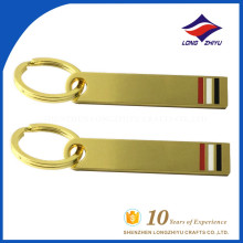 Very simple gold metal key chain with red white black color