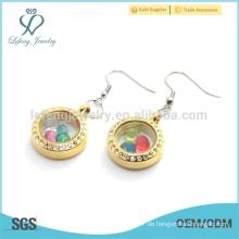Art und Weiseschmucksache-Goldkristall-schwimmende Ohrringe, reizende runde Glasfrauenohrringe