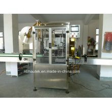 Machine d'insertion et de rétractation d'étiquettes de bouteilles