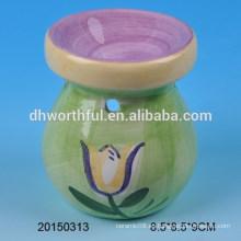 Quemador de aceite de cerámica de decoración casera verde con diseño de flor