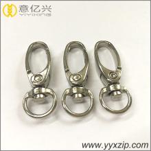 Crochets à pression métalliques pivotants pour sacs
