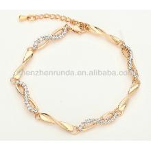 Kundengebundenes heißes Edelstahl-rosafarbenes Goldzircon-glückliches Charmearmband für Frauen