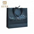 contemporary durable paper gift bag with ribbon bow tie