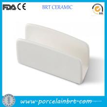 Titular de guardanapo de cerâmico branco personalizado para venda