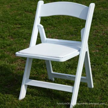 Chaise pliante en résine blanche rembourrée en gros