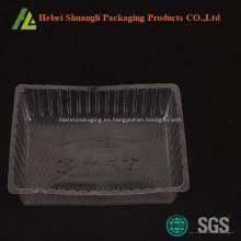 Bandeja desechable de pastel de plástico transparente