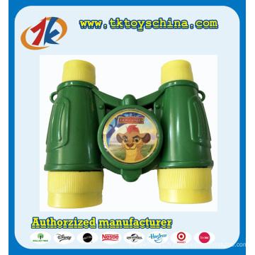 Jumelles en plastique colorées de jouets de mini télescope d'enfants à vendre