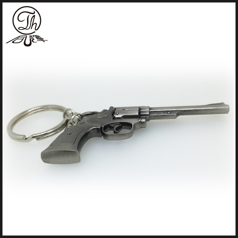 Antique revolver metal keychain