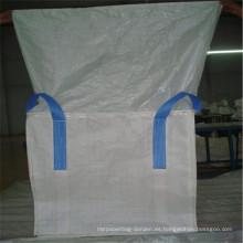 Bolsa jumbo con tapa de lona y parte inferior plana.