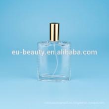 Botella de perfume con flor tapa en forma triangular