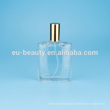 perfume bottle with flower cap in triangular shape