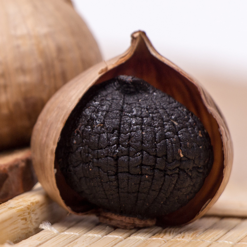 peeled single bulb black garlic