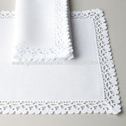 100% table linens, adorned with lacework