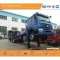 SINOTRUK 8X4 LHD front lifting flatbed truck