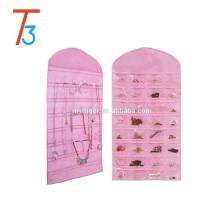Nueva bolsa de organizador de joyería de tela colgante bolsa de organizador de accesorios con 32 bolsillos y 18 bucles