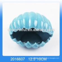 Venta al por mayor del cenicero de cerámica de la forma de la concha del mar de la alta calidad