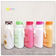 Hot sale triangle shape glass water bottle with plastic protective sleeve