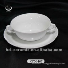 ceramic coffee cup with two handles and saucer