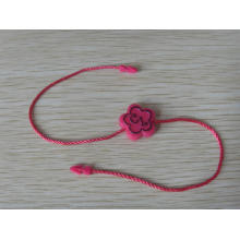 Pink paper tags with string