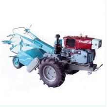 Гусеничный трактор с роторным культиватором