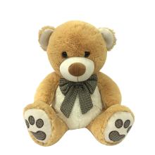 Ours en peluche brun avec ruban