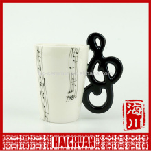 ceramic mug with music notes decal and handle