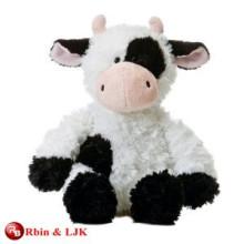 Juguete de peluche de vaca blanco y negro