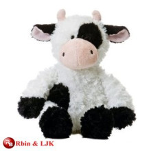 white and black cow plush toy