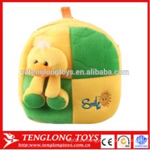 El juguete amarillo de la felpa del pato embroma las bolsas de escuela